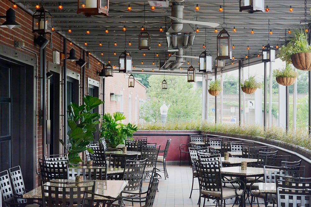 Eleven restaurants open air deck patio with table and chairs to seat 50 guests